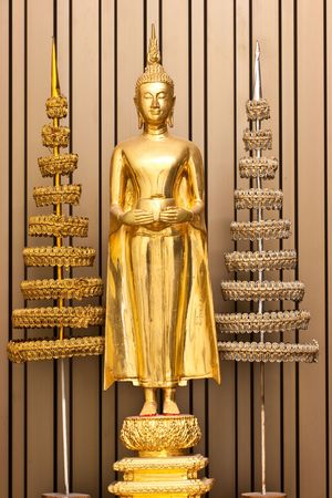 budha: Golden Budha hold an alms bowl with colonation