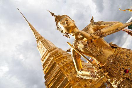 Golden Angel with Pagoda Wat Pra Kaeo, Thailand Stock Photo