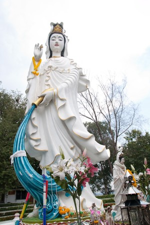 huge white quan-yin in chinese temple Stock Photo