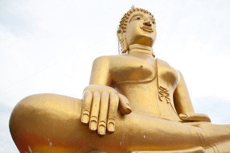 huge gold buddha statue in thai temple Stock Photo