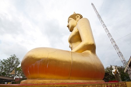 side huge golden buddha lanscape in thai temple