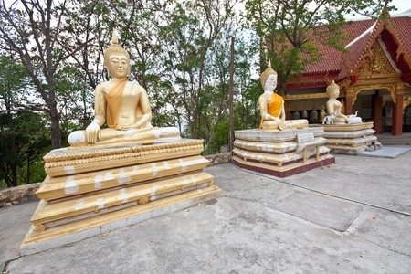 triple meditation buddha statue in thai temple Stock Photo