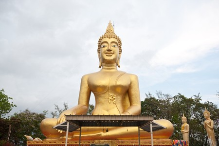 front huge golden buddha in thai temple