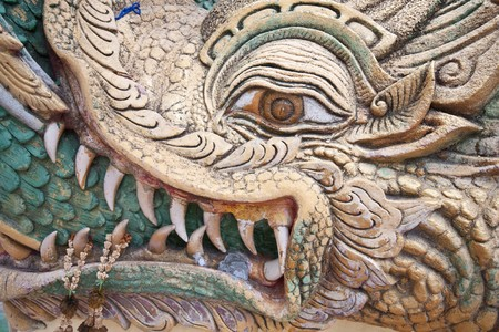 dragon face carved in thai temple