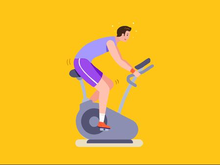 Fitness man riding stationary bicycle