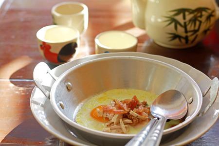 vietnamese food: egg in pan with pork and sausage Vietnamese food
