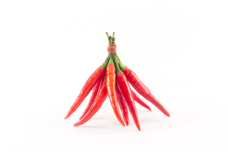 spur: red chili spur pepper on white background Stock Photo