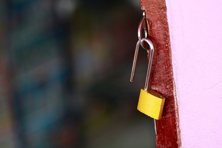 unlocked: unlocked on old wooden door with golden metal lock