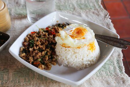 Rice and fried pork with basil chilli and garlic the hot and spicy dishes that are popular and delicious in Thailand call Pad Ka-proa