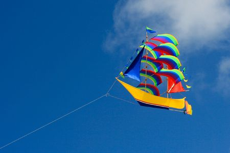 Colorful ship kite in the blue sky. Stock Photo