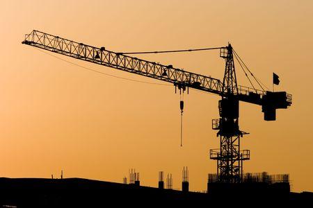 crane parts: Gr�as de alto a la puesta del sol. Foto de archivo