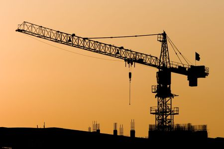 tower crane: High Cranes at sunset. Stock Photo
