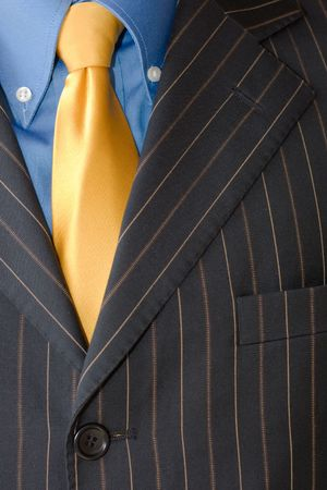 Detail of a Business man Suit with blue yellow Stock Photo