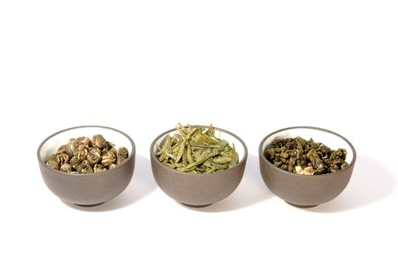 Three bowls of herbal tea. Close-up, isolated on white. Stock Photo