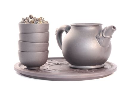 Teapot and cups. Close-up, isolated on white.
