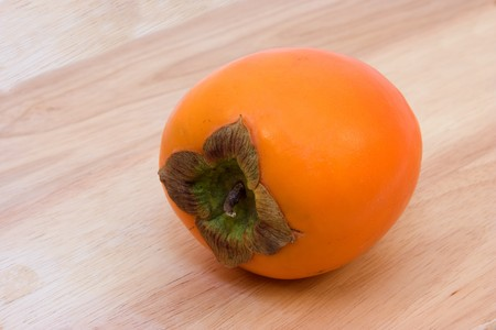 Persimmon on the table. Stock Photo
