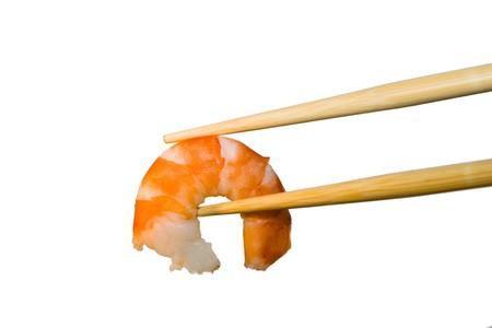 Shrimp in chopsticks. Stock Photo