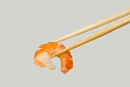 Shrimp in chopsticks. photo