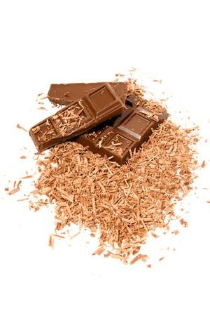 sweetness: Milk chocolate, close-up. Isolated on white. Stock Photo