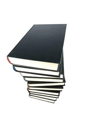 白い背景上に分離されて黒書籍のスタック。