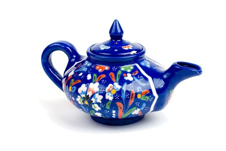crafted: Blue teapot isolated on white. Stock Photo