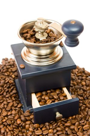 Coffee grinder ower coffe beans. Stock Photo