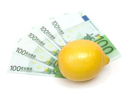 Banknotes and lemon isolated on white. Stock Photo