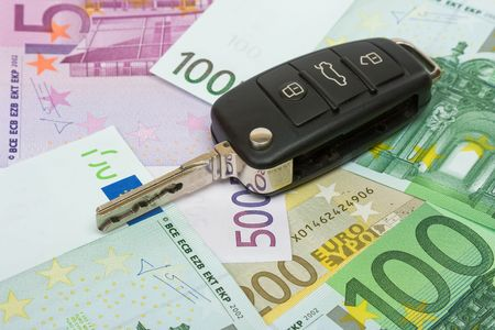 Car key on money background. Stock Photo - 5050332