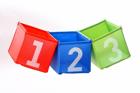 Multicolored containers with numbers isolated on white photo