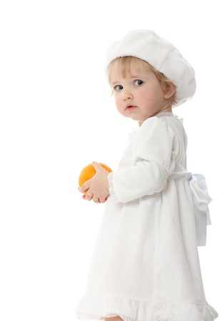 Studio portrait of baby with mellow orange in white clothes isolated on white photo