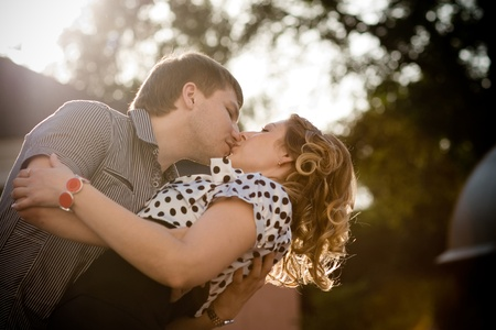 Exciting kiss of a young beautiful couple