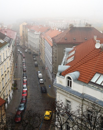 Top view of tiled red roofs, hidden in the fog Stock Photo - 10720163