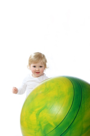 Portrait of a baby with gymnastic ball isolated on white photo