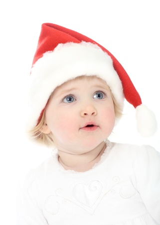 Cute baby girl pending Christmas miracle photo