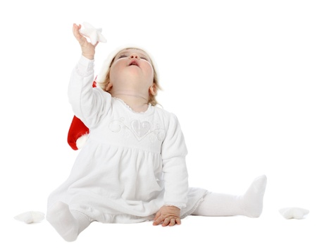 Cute baby girl pending Christmas miracle Stock Photo - 10816584