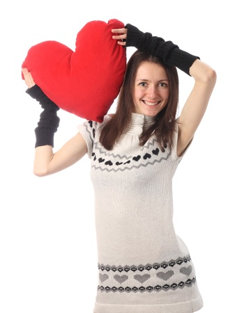 Happy fashionable young woman holding red Valentines heart and smiling; isolated on white photo