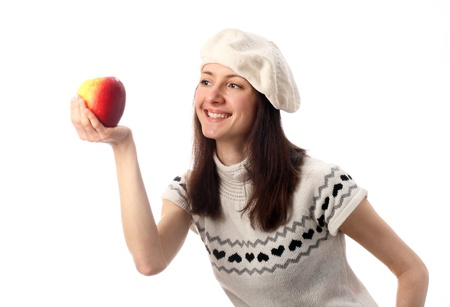 Happy young woman looking at juicy red apple; isolated on white photo