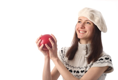 Happy beautiful young woman holding red apple, copyspace; isolated on white photo