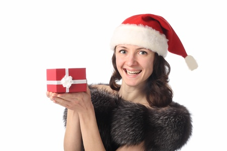 Portrait of a beautiful young lady holding a present in red box and laughing isolated on white Stock Photo - 10867453