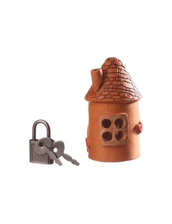 Clay house and padlock with keys isolated on white photo