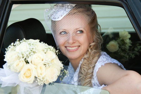 The bride is looking out the car. Wedding day photo