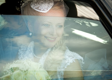 The bride in the car.Wedding day. photo