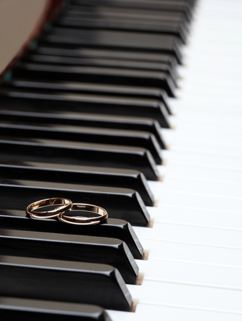 Melody of love: wedding rings on piano photo