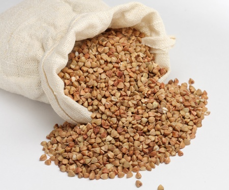 Buckwheat in the packet on white background Stock Photo - 11031322