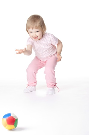 Baby girl is playing with ball on white background Stock Photo - 11121410