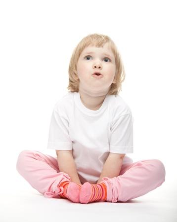 asombro: La ni�a con la boca abierta de asombro en el fondo blanco Foto de archivo