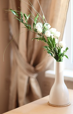 Still life: beautiful flowers in a white vase photo
