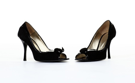Pair of high-heeled black shoes isolated on white background photo