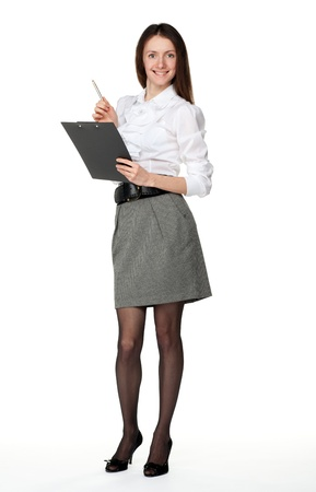 Young smiling businesswoman in white blouse and skirt with clipboard and a pen; isolated on white Stock Photo - 11174331