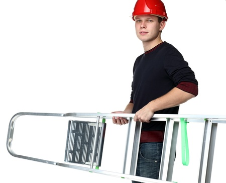 Young man in red hard hat holding aluminium stepladder isolated on white photo